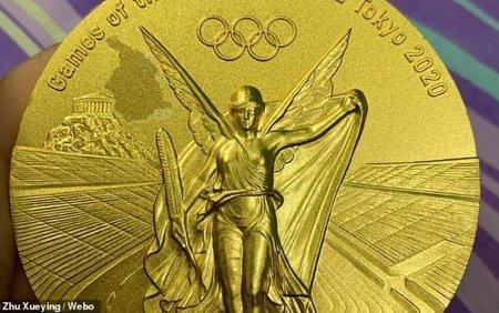 O sportiva din China se plange ca medalia castigata la Jocurile Olimpice se... cojeste