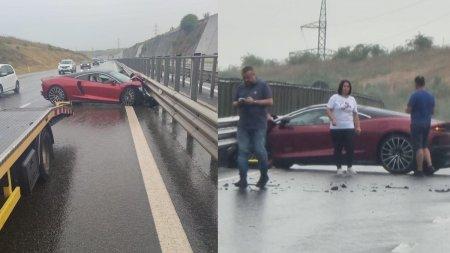 Bolid de lux nou-nout distrus pe jumatate, dupa ce s-a izbit de parapet, pe autostrada A3, in Cluj