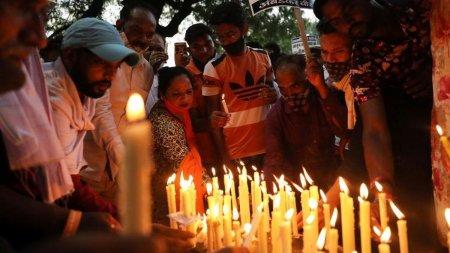 Un <span style='background:#EDF514'>PREOT</span> si trei ajutoare, arestati si pusi sub acuzare pentru viol in grup si uciderea unei fete de 9 ani, in India