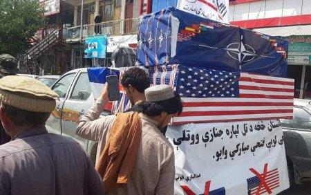 FOTO. Talibanii au organizat o <span style='background:#EDF514'>INMORMANTARE</span> pentru fortele americane si NATO, dupa retragerea din Afganistan