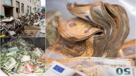 Mii de bancnote ude si pline de noroi adunate de angajatii bancii Federale din Germania pentru a fi curatate si spalate dupa <span style='background:#EDF514'>INUNDATIILE</span> devastatoare