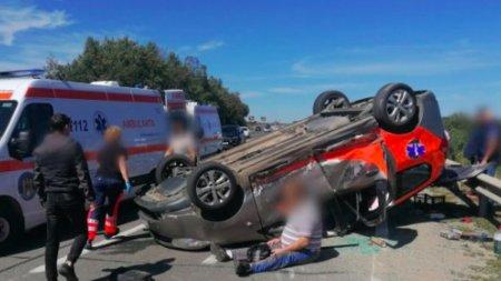 O ambulanta rasturnata pe sosea, patru victime si trafic ingreunat, dupa un accident pe DN1, la Sibiu