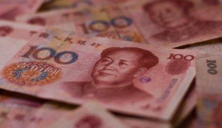 Economia chinezeasca incetineste pe fondul delta si scaderii consumului
