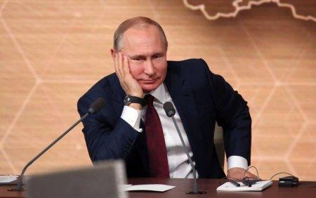 Zeci de persoane din anturajul lui Vladimir Putin au fost <span style='background:#EDF514'>DIAGNO</span>sticate cu COVID-19