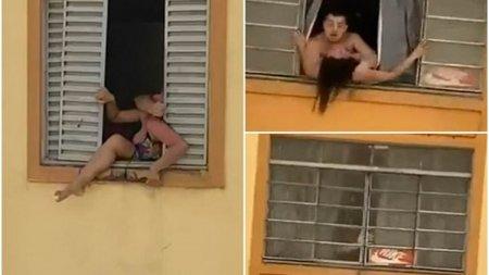 O femeie insarcinata incearca sa sara pe geam de teama sotului abuziv in <span style='background:#EDF514'>BRAZIL</span>ia