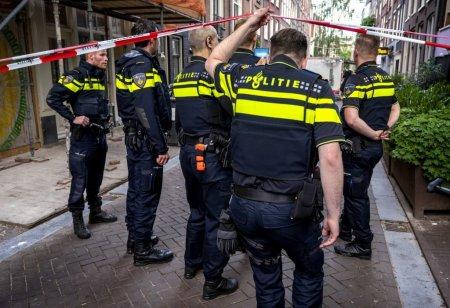 Doi morti si un ranit in Olanda, dupa ce un barbat a inceput sa traga cu arbaleta de la <span style='background:#EDF514'>BALCON</span>. Politistii l-au arestat