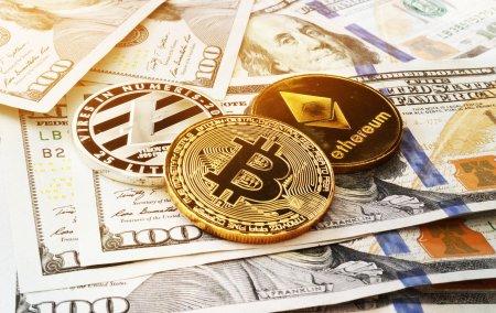 Bitcoin si Ethereum scad dupa o saptamana in care au revenit la maximele anterioare