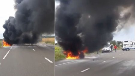 O <span style='background:#EDF514'>MASINA</span> a luat foc in mers, la Vrancea, fara sa fie implicata in vreun accident. Pompierii intervin pentru stingerea flacarilor