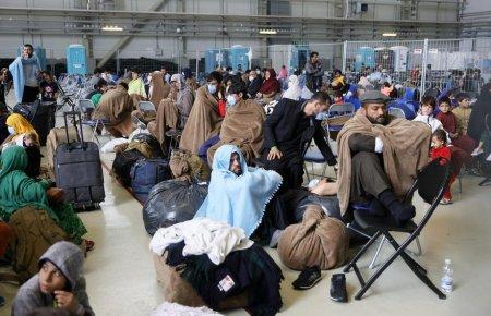 Comunitatea celor 10.000 de uitati. Mii de afgani, printre care si 2.000 femei <span style='background:#EDF514'>GRAV</span>ide, blocati la o baza militara din Germania
