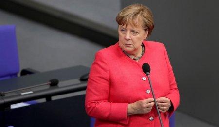 Ipostaze amuzante in care a fost surprinsa Angela Merkel (FOTO)