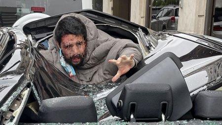 A scapat cu viata dupa ce a cazut noua etaje si a aterizat pe un BMW. Fotografiile au relevat un amanunt neasteptat