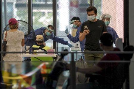 Lectia unui mic stat asiatic in pandemie: impune noi restrictii, desi are 83% din populatie vaccinata. Ce sta in spatele acestei decizii