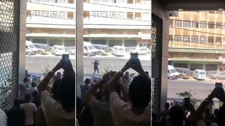 Scene de razboi in Beirut, dupa violentele de la mitingul Hezbollah. Un barbat cu un aruncator de grenade este impuscat in plina strada