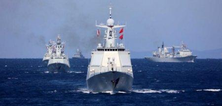 Rusia si China isi afiseaza prietenia. <span style='background:#EDF514'>NAVE</span> militare ale celor doua tari traverseaza impreuna o stramtoare din Marea Japoniei