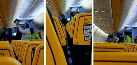 Barbat dat jos din avion la Cluj, in aplauzele pasagerilor, dupa ce a refuzat sa poarte masca. Politistii au fost nevoiti sa intervina
