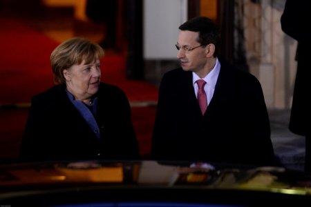 Declaratie surprinzatoare data de Merkel in conflictul dintre UE si Polonia. Neintelegerile politice nu se pot rezolva prin procese in instanta. Tonul negativ fata de Polonia nu e bun