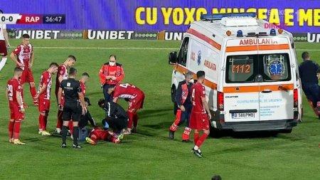 Momente de panica la meciul Dinamo - Rapid, dupa ce un jucator a fost urcat in ambulanta cu masca de oxigen pe fata