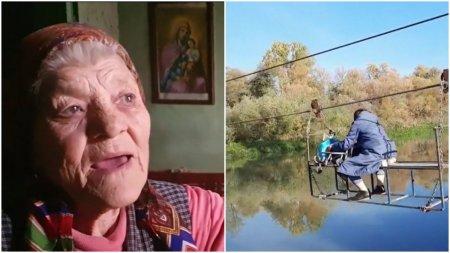 O batrana de 94 de ani traverseaza raul Mures cu tiroliana